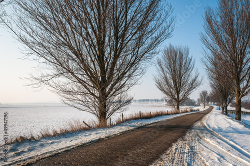 Narrow country road in winter