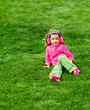 Preschool girl sitting on the hill