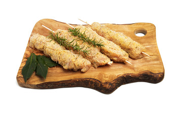 skewers of chicken and turkey with breadcrumbs