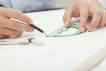 Hands male architect to make drawings using pencil and compass