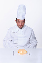 Chef sitting to eat a burger