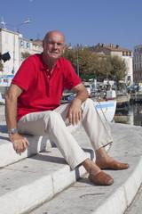 serene 60's man enjoying his holiday