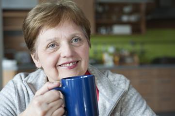 happy senior woman at home -  drinking