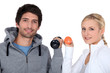 Young couple with dumbbells