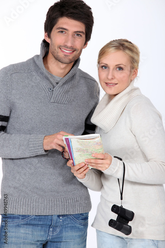 Couple with a map book