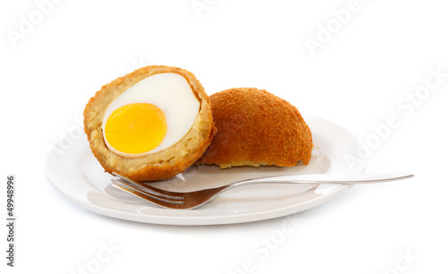Egg ball (Eierbal) cut in half on saucer