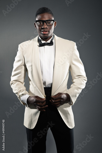 Stylish black american man in suit with glasses. Fashion studio