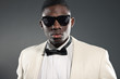 Stylish black american man in suit with sunglasses. Fashion stud