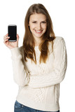 Happy young woman showing her mobile phone