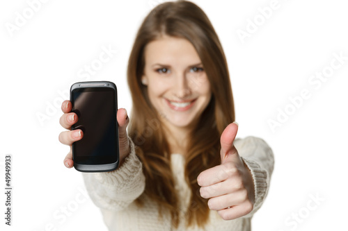 Closeup of happy woman showing mobile phone gesturing thumb up