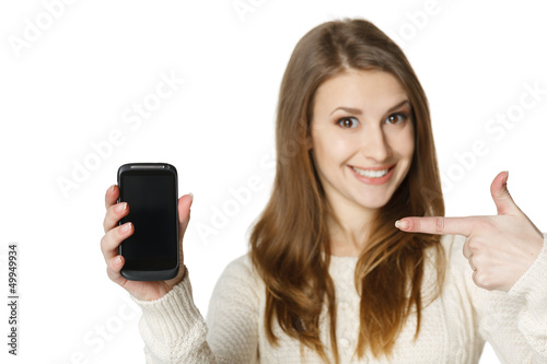 Closeup of happy young woman pointing at mobile phone