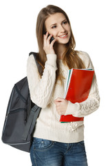 Woman with backpack and books talking on cell phone
