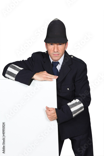 Policeman with blank advertising board