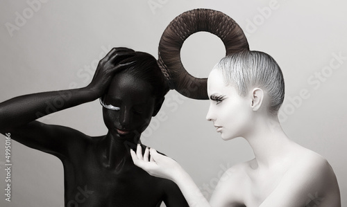Ying & Yang Symbol. East. Women Painted Body in Black & White