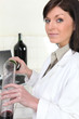 Woman oenologist in laboratory