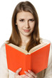 Closeup of smiling woman student with opened book