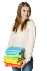 Playful female carrying a heap of books