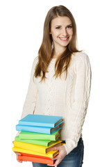 Young happy beautiful woman holding books