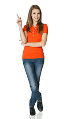 Woman pointing up standing in full length