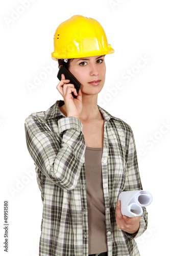 Tradeswoman using mobile phone