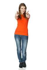 Happy young casual woman pointing at you