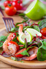 Salad with shimp, tomato, lime and chard