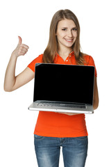 Casual female showing laptop screen and gesturing thumb up
