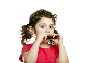 small girl with harmonica