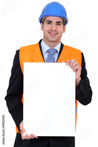 Inspector with a poster