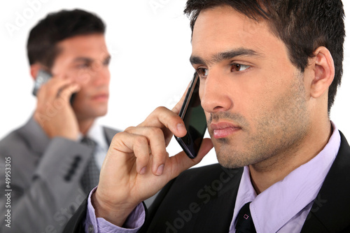 businessmen talking on their cells