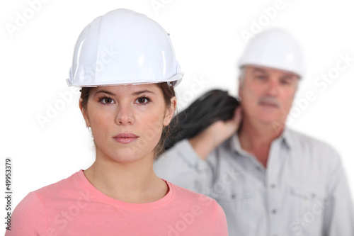 Builder with young female student