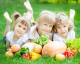 Children having picnic outdoors