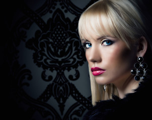 Beautiful blonde woman in luxury fur coat