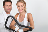 Couple working out in a gym