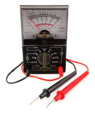 Vintage analog multimeter with poisitve negatives leads