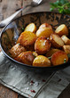 Oven-baked potatoes with sea salt, pink pepper and herbs