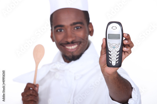 A black chef handing the phone over.