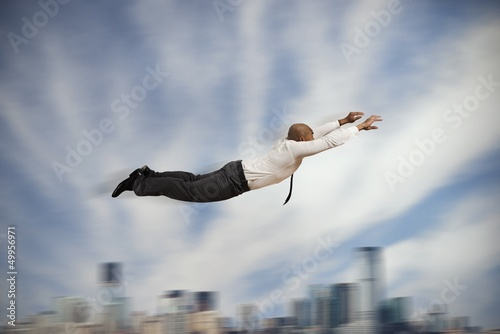 Flying Super hero businessman