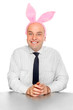 An successful manager with rabbit ears. Happy easter concept.