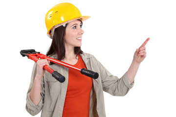 A handywoman with pliers.