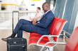 modern african businessman using tablet computer at airport