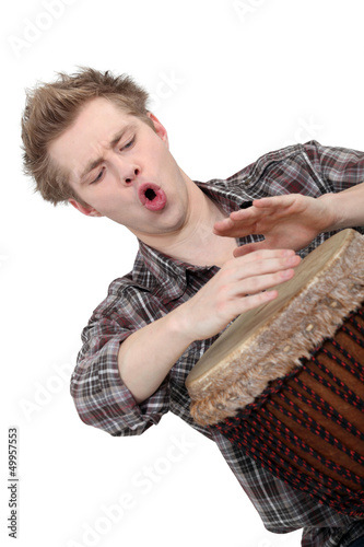 Oblique image of boy playing drum