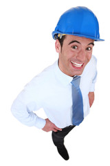happy businessman with a helmet on his head