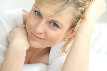 Young relaxed woman in white