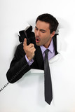 A businessman yelling at his phone.
