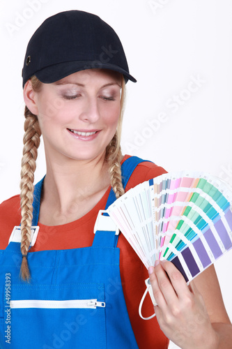 Woman choosing which color paint to use