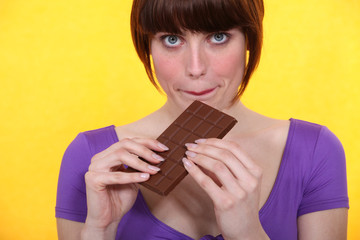 Woman with a bar of chocolate