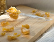 candied ginger on wooden board
