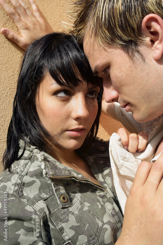 Passionate couple up against wall