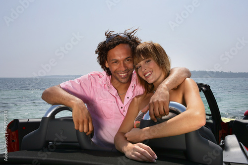 Happy couple in a convertible car